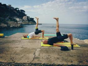 "Pilates for Cyclists in Nice | Markus and Karl doing the challenging hip extensor exercise ""shoulder bridge"""