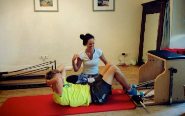 """Training at the CREW Pilates Studio in Antibes   Competitive cyclist and triathlete Markus working on his abdominal/hip precision in """"chest lift"""" on the wunda chair"""