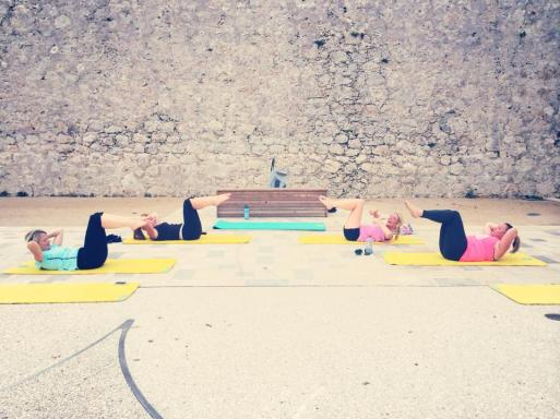 "Outdoor training in Antibes | Bluewater ladies achieving ""chest lift"" on the mat"
