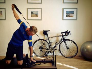 """Training in the CREW Pilates Studio   Competitive cyclist Arvid achieving """"side kneeling arm series"""" on the Allegro 1 Reformer"""