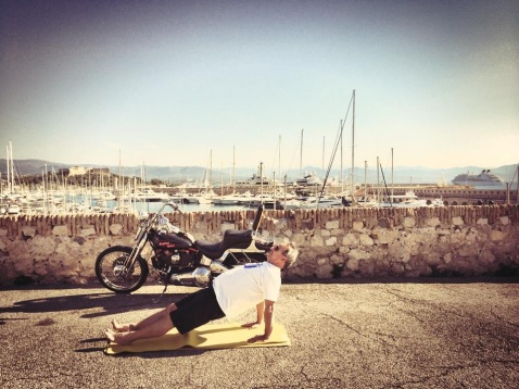 """Outdoor training in Antibes   Captain Chris doing """"back support"""" on the mat with his Harley Davidson and super yachts in the background"""