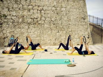 "Outdoor training in Antibes | Camper & Nicholson's ladies achieving ""hamstring stretch"" with the magic circle"