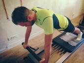 "On the reformer at the CREW Pilates Studio | Cutting Shop owner and sportsman Marc Ramo achieving ""front support"""