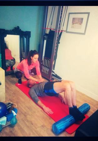 """CREW Pilates Studio   A hamstring killer! Competitive cyclist Arvid doing """"pelvic curl"""" on the foam roller"""