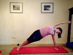 "CREW Pilates Studio in Antibes | Fiona gracefully performing the advanced ""side bend"" on the mat"