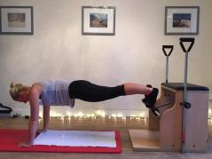 "Training on the wunda chair at the CREW Pilates Studio | Chief Stewardess Hannah working hard at her Pilates ""push ups"""
